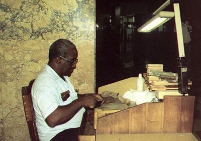 Man make cigars in Havana Libre