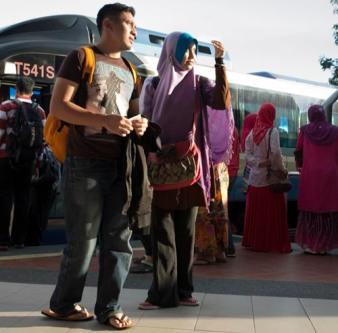 tourist couple returns to Kuala Lumpur